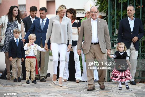 Princess Charlene of Monaco Prince Jacques of Monaco Prince Albert II of Monaco and Princess Gabriella of Monaco arrive to attend the Monaco annual...