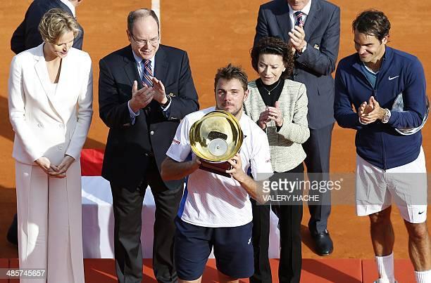 Princess Charlene of Monaco, Prince's Albert II of Monaco, Elisabeth Anne De Massy and Switzerland's Roger Federer congratulate Switzerland's...