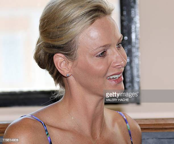 Princess Charlene of Monaco smiles as she visits the exhibition entitled 'L'Histoire du Mariage Princier' devoted to her marriage with Prince Albert...