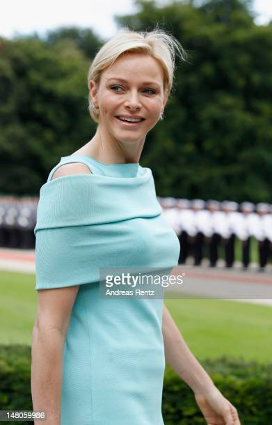 Princess Charlene of Monaco smiles upon her arrival at Schloss Bellevue Palace on July 9 2012 in Berlin Germany Prince Albert II and Princess...