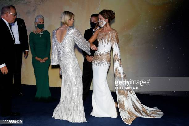 Princess Charlene of Monaco speaks with English actress Kate Beckinsale ahead of the 2020 Monte-Carlo Gala for Planetary Health in Monaco on...