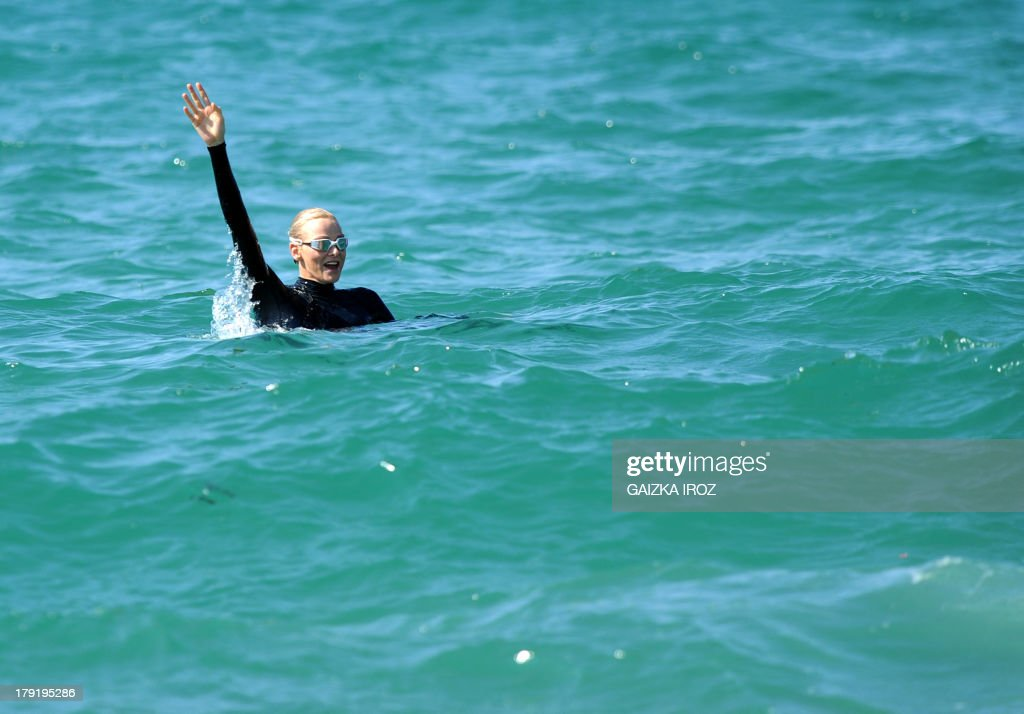 Princess Charlene of Monaco swims in the sea as she takes part in an aquatic security awareness campaign organised by Capbreton's coastal rescue club, in Capbreton, southeastern France, on September 1, 2013.