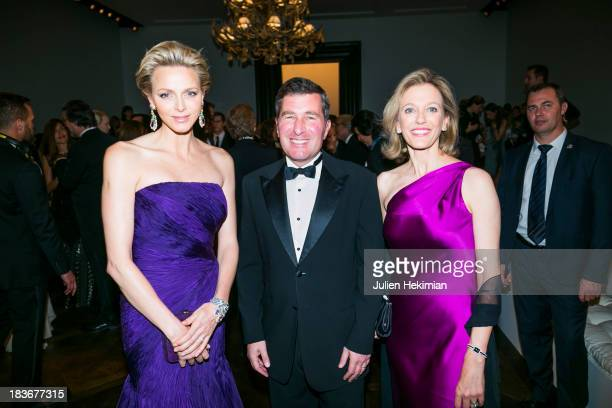 Princess Charlene of Monaco US Ambassador to France Charles H Rivkin and his wife Susan Tolson attend the presentation of the Ralph Lauren Fall 13...