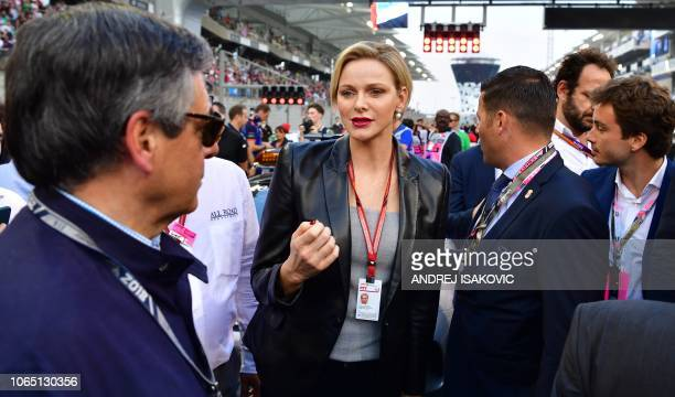 Princess Charlene of Monaco walks the grid prior to the Abu Dhabi Formula One Grand Prix at the Yas Marina circuit on November 25 in Abu Dhabi