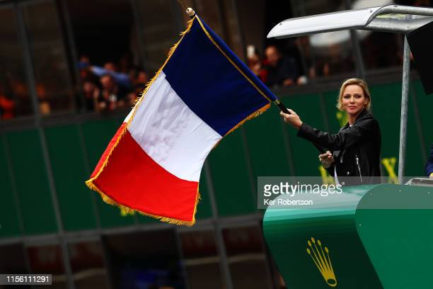Princess Charlene of Monaco waves the French tricolour to start the Le Mans 24 Hour Race at the Circuit de la Sarthe on June 15, 2019 in Le Mans,...