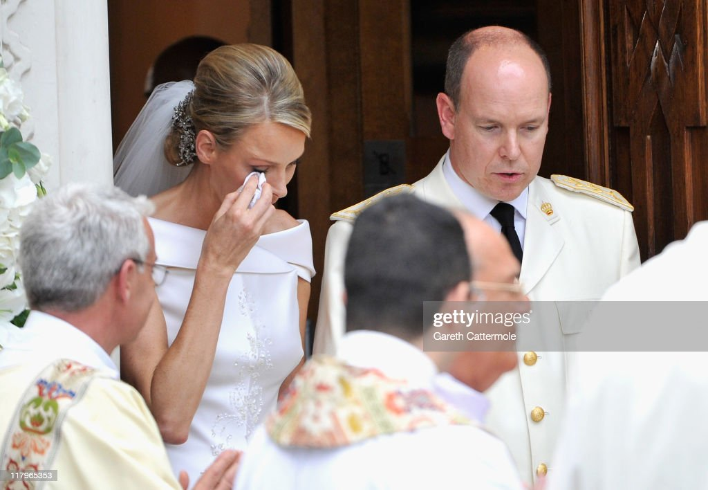 Princess Charlene of Monaco wipes away a tear as she and Prince Albert II of Monaco leave Sainte Devote church after their religious wedding ceremony at the Prince's Palace of Monaco on July 2, 2011 in Monaco. The Roman-Catholic ceremony followed the civil wedding which was held in the Throne Room of the Prince's Palace of Monaco on July 1. With her marriage to the head of state of the Principality of Monaco, Charlene Wittstock has become Princess consort of Monaco and gains the title, Princess Charlene of Monaco. Celebrations including concerts and firework displays are being held across several days, attended by a guest list of global celebrities and heads of state.