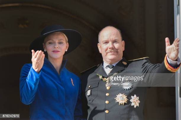 Princess Charlene of Monaco with Prince Albert II of Monaco greet the crowd from the Palace's balcony during the Monaco National Day Celebrations on...