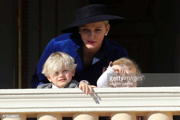 Princess Charlene of Monaco with Prince Jacques and Princess Gabriella appear to the public from the balcony of the Monaco Palace during the...