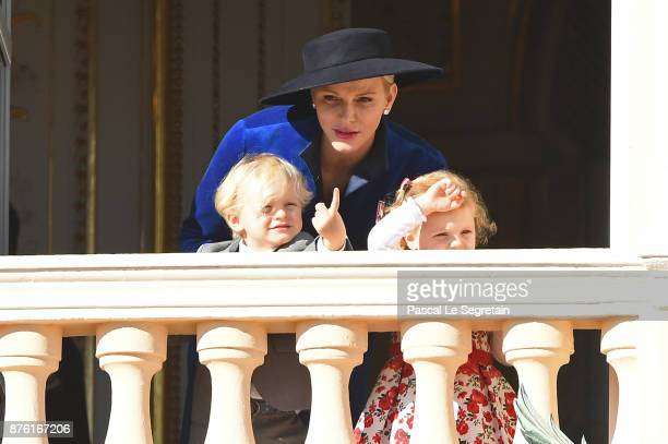 Princess Charlene of Monaco with Prince Jacques of Monaco and Princess Gabriella of Monaco greet the crowd from the palace's balcony during the...