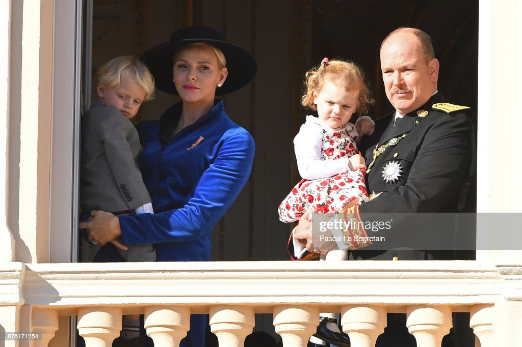 Princess Charlene of Monaco with Prince Jacques of Monaco and Prince Albert II of Monaco with Princess Gabriella of Monaco greet the crowd from the palace's balcony during the Monaco National Day Celebrations on November 19, 2017 in Monaco, Monaco.