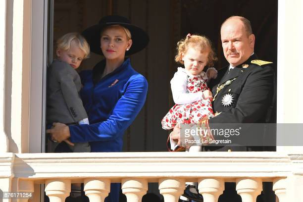 Princess Charlene of Monaco with Prince Jacques of Monaco and Prince Albert II of Monaco with Princess Gabriella of Monaco greet the crowd from the...