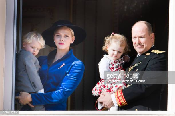 Princess Charlene of Monaco with Prince Jacques of Monaco, Prince Albert II of Monaco with Princess Gabriella of Monaco greet the crowd from the...