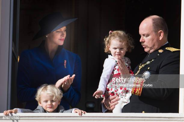 Princess Charlene of Monaco with Prince Jacques of Monaco Prince Albert II of Monaco with Princess Gabriella of Monaco greet the crowd from the...