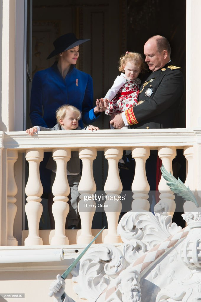 Princess Charlene of Monaco with Prince Jacques of Monaco, Prince Albert II of Monaco with Princess Gabriella of Monaco greet the crowd from the Palace's balcony during the Monaco National Day Celebrations on November 19, 2017 in Monaco, Monaco.