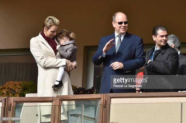 Princess Charlene of Monaco with Princess Gabriella of Monaco and Prince Albert II of Monaco greet the crowd prior the Sainte Devote Rugby Tournament...
