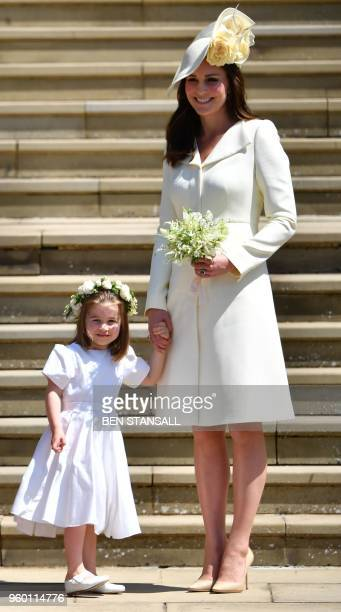 TOPSHOT Princess Charlotte and Britain's Catherine Duchess of Cambridge leave the wedding ceremony of Britain's Prince Harry Duke of Sussex and US...