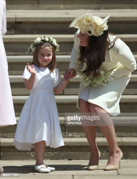 Princess Charlotte and Catherine Duchess of Cambridge leave St George's Chapel after the wedding of Prince Harry and Meghan Markle in St George's...