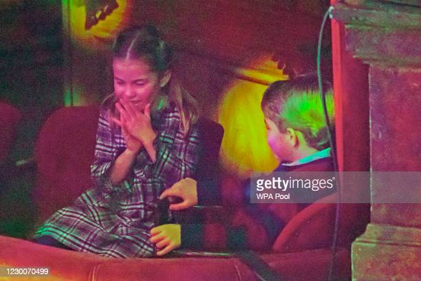 Princess Charlotte and Prince George attend a special pantomime performance at London's Palladium Theatre, hosted by The National Lottery, to thank...