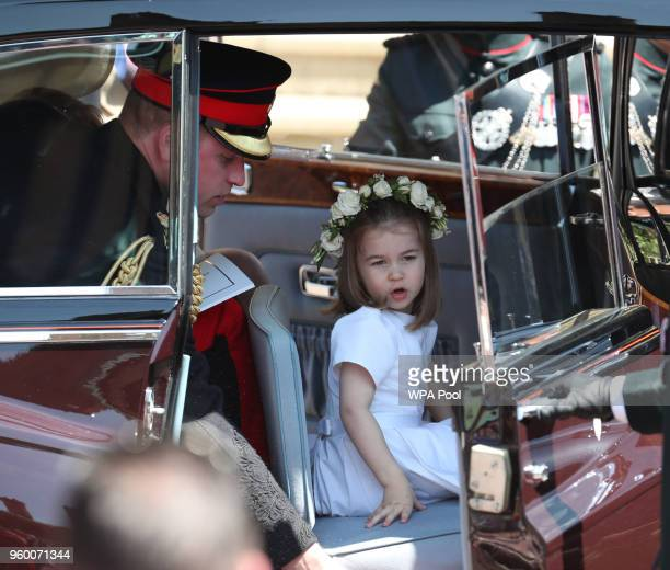Princess Charlotte and Prince William Duke of Cambridge leave St George's Chapel after the wedding of Prince Harry and Meghan Markle in St George's...