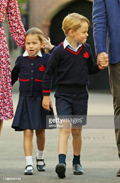 Princess Charlotte arrives for her first day at school with her brother Prince George and her parents the Duke and Duchess of Cambridge at Thomas's...