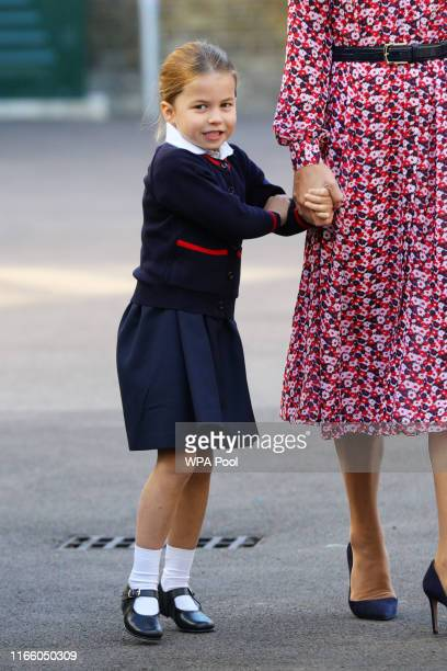 Princess Charlotte arrives for her first day of school with her brother Prince George and her parents the Duke and Duchess of Cambridge at Thomas's...