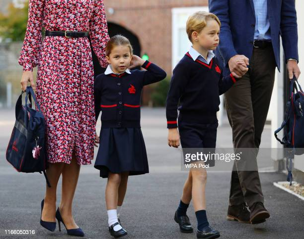 Princess Charlotte arrives for her first day of school, with her brother Prince George and her parents the Duke and Duchess of Cambridge, at Thomas's...