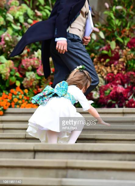 Princess Charlotte falls on the steps as the bridesmaids and page boys arrive for the wedding of Princess Eugenie to Jack Brooksbank at St George's...