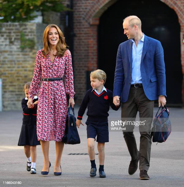 Princess Charlotte, hide behind her mother the Duchess of Cambridge as she arrives for her first day at school, with her brother Prince George and...