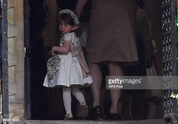 Princess Charlotte of Cambridge a bridesmaid attends the wedding ceremony of her aunt Pippa Middleton to James Matthews at St Mark's Church as the...