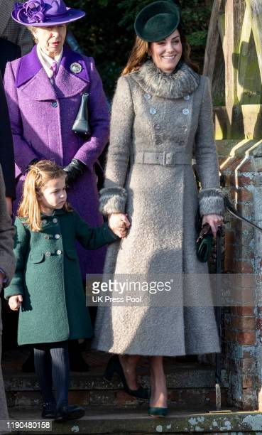 Princess Charlotte of Cambridge and Catherine Duchess of Cambridge curtsey to the Queen at the Christmas Day Church service at Church of St Mary...