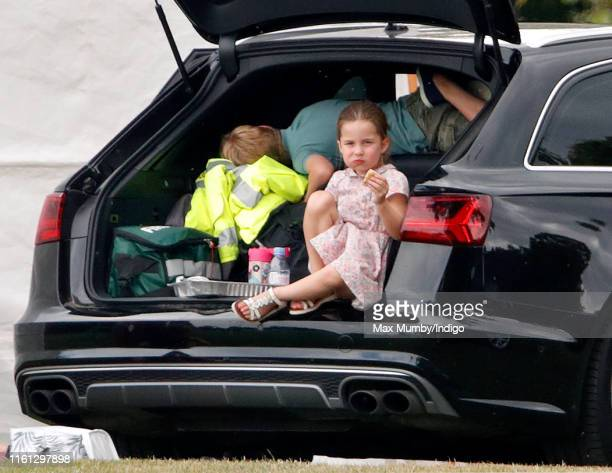 Princess Charlotte of Cambridge and Prince George of Cambridge attend the King Power Royal Charity Polo Match in which Prince William Duke of...