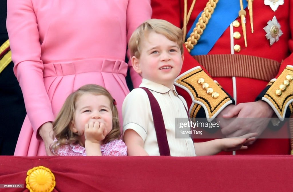 Princess Charlotte of Cambridge and Prince George of Cambridge look on from the balcony during the annual Trooping The Colour parade at the Mall on June 17, 2017 in London, England.