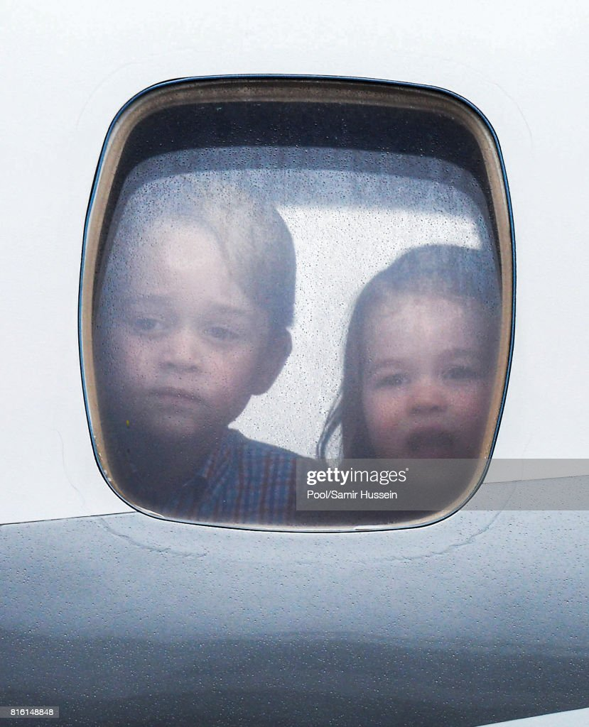 Princess Charlotte of Cambridge and Prince George of Cambridge look out of the window of the plane as they arrive at Warsaw airport during an official visit to Poland and Germany on July 17, 2017 in Warsaw, Poland.