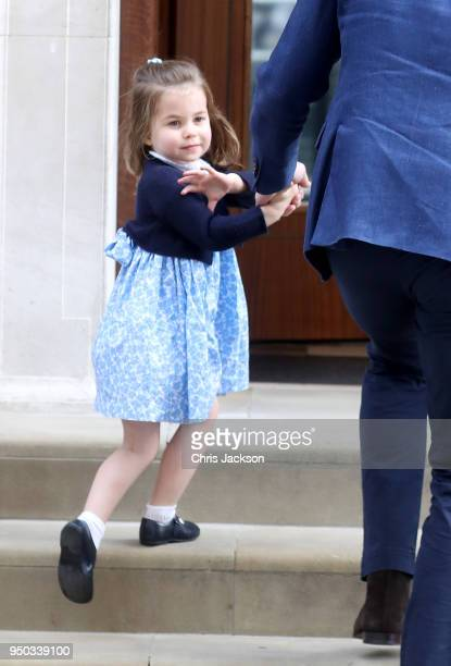 Princess Charlotte of Cambridge arrives with Prince William Duke of Cambridge and Prince George of Cambridge at the Lindo Wing after Catherine...