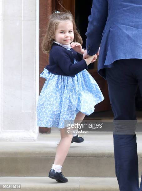 Princess Charlotte of Cambridge arrives with Prince William, Duke of Cambridge and Prince George of Cambridge at the Lindo Wing after Catherine,...