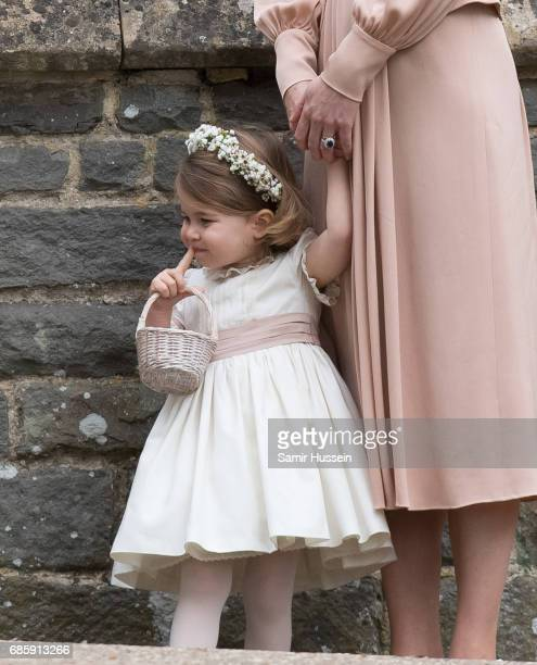 Princess Charlotte of Cambridge attends the wedding Of Pippa Middleton and James Matthews at St Mark's Church on May 20, 2017 in Englefield Green,...