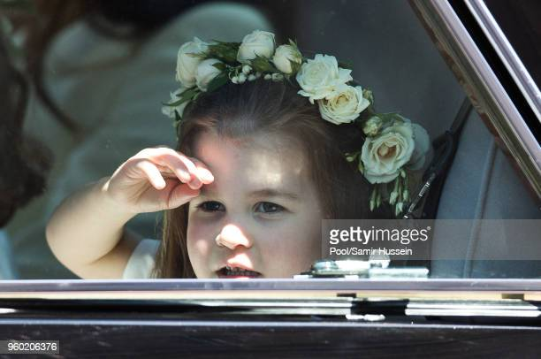 Princess Charlotte of Cambridge attends the wedding of Prince Harry to Ms Meghan Markle at St George's Chapel Windsor Castle on May 19 2018 in...