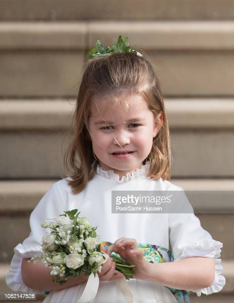 Princess Charlotte of Cambridge attends the wedding of Princess Eugenie of York and Jack Brooksbank at St George's Chapel in Windsor Castle on...