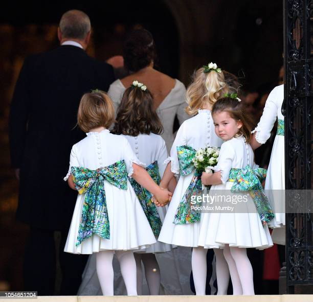 Princess Charlotte of Cambridge attends the wedding of Princess Eugenie of York and Jack Brooksbank at St George's Chapel on October 12, 2018 in...