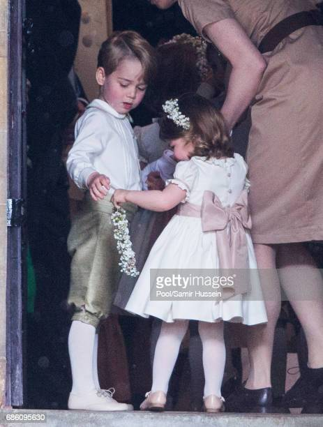 Princess Charlotte of Cambridge bridesmaid and Prince George of Cambridge attend the wedding Of Pippa Middleton and James Matthews at St Mark's...