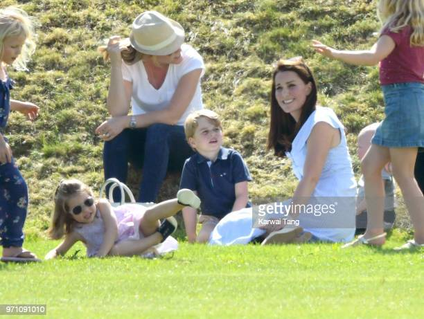 Princess Charlotte of Cambridge Catherine Duchess of Cambridge and Prince George of Cambridge attend the Maserati Royal Charity Polo Trophy at...
