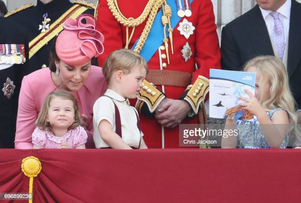 Princess Charlotte of Cambridge Catherine Duchess of Cambridge Prince George of Cambridge and Savannah Phillips look out from the balcony of...