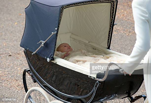 Princess Charlotte of Cambridge is pushed in a pram by her mother Catherine, Duchess of Cambridge as they arrive at the Church of St Mary Magdalene...