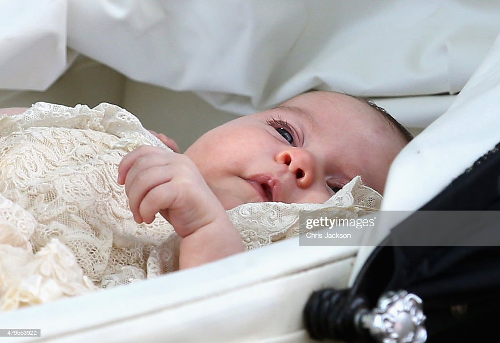 Princess Charlotte of Cambridge is pushed in her silver cross pram as she leavesthe Church of St Mary Magdalene on the Sandringham Estate for the Christening of Princess Charlotte of Cambridge on July 5, 2015 in King's Lynn, England.