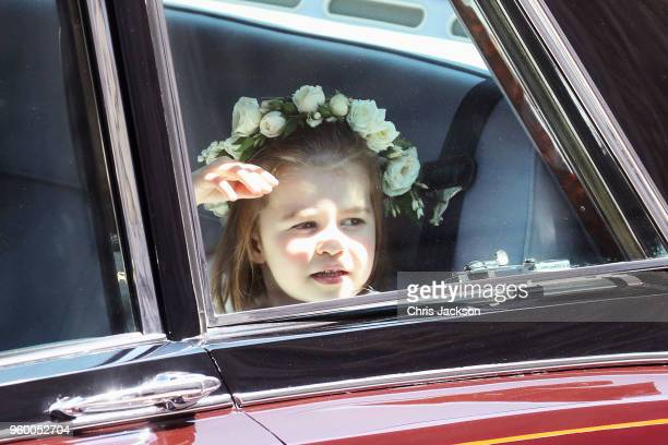 Princess Charlotte of Cambridge of Cambridge arrives at the wedding of Prince Harry to Ms Meghan Markle at St George's Chapel Windsor Castle on May...