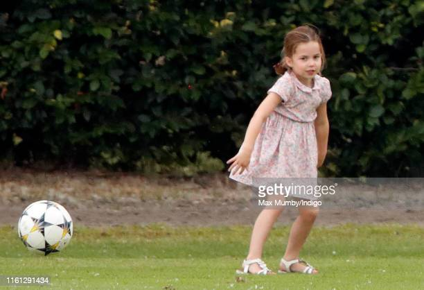 Princess Charlotte of Cambridge plays football as she attends the King Power Royal Charity Polo Match in which Prince William Duke of Cambridge and...