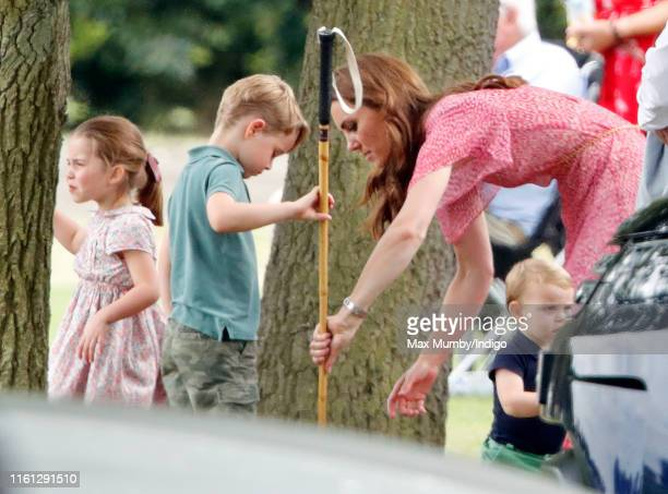Princess Charlotte of Cambridge, Prince George of Cambridge, Catherine, Duchess of Cambridge and Prince Louis of Cambridge attend the King Power...