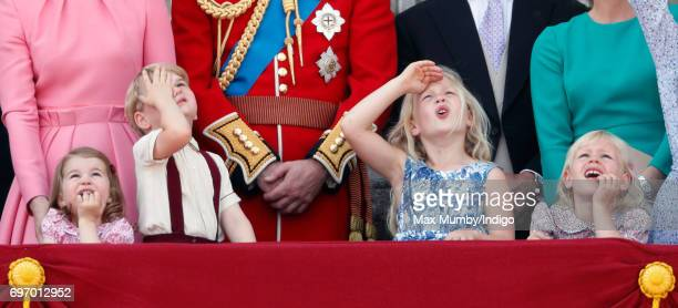 Princess Charlotte of Cambridge Prince George of Cambridge Savannah Phillips and Isla Phillips watch the flypast from the balcony of Buckingham...