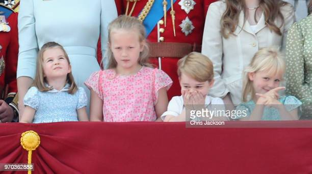 Princess Charlotte of Cambridge Savannah Phillips Prince George of Cambridge and Isla Phillips watch the flypast on the balcony of Buckingham Palace...