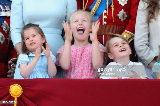 Princess Charlotte of Cambridge Savannah Phillips Prince George of Cambridge watch the flypast on the balcony of Buckingham Palace during Trooping...